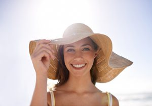 How can aesthetic practitioners best advise their patients about staying safe in the sun?