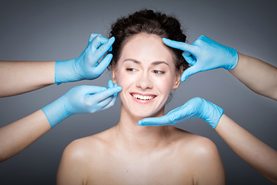 Smiling woman having skin checkup before plastic surgery.