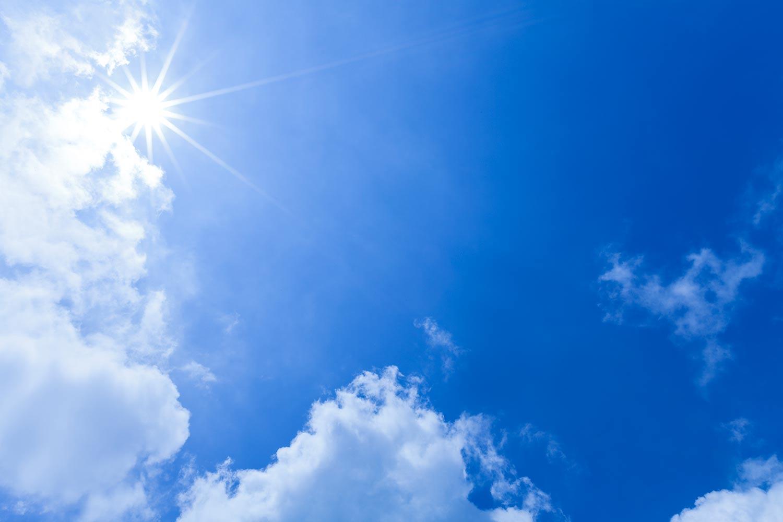 Sun shining in the bright blue sky
